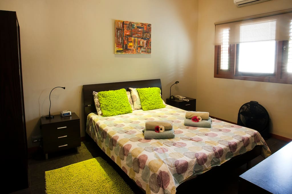 Queen beds, air conditioning units in both bedrooms and living room