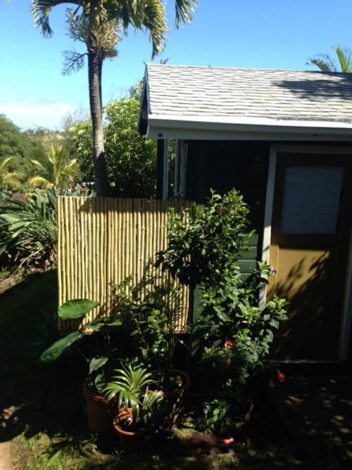 Privacy bamboo wall at the tub and shower.  Lucky we live Maui!  Warm days and clear nights!