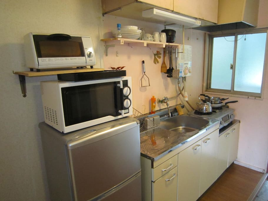 kitchen has refrigerator, oven, microwave and grill