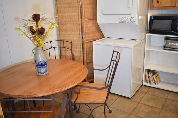 microwave, toaster oven, coffee pot, in dinette area.Full fridge in utility room.