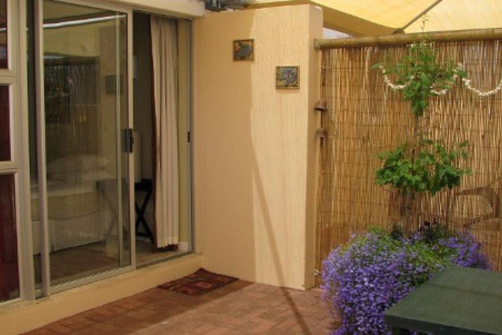 Outdoor patio area with private room access