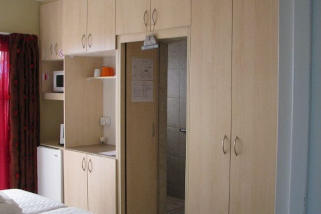 Ample cupboard space, coffee and tea making facilities, bar fridge, microwave, stove top and cable TV
