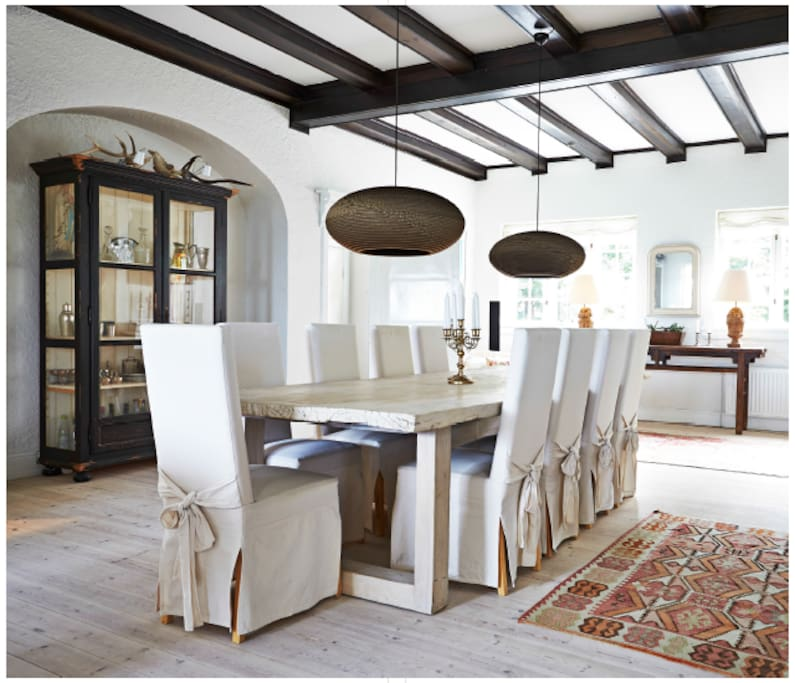 Large dining area with fireplace adjacent to a fully equipped kitchen, in case the evening gets cool.