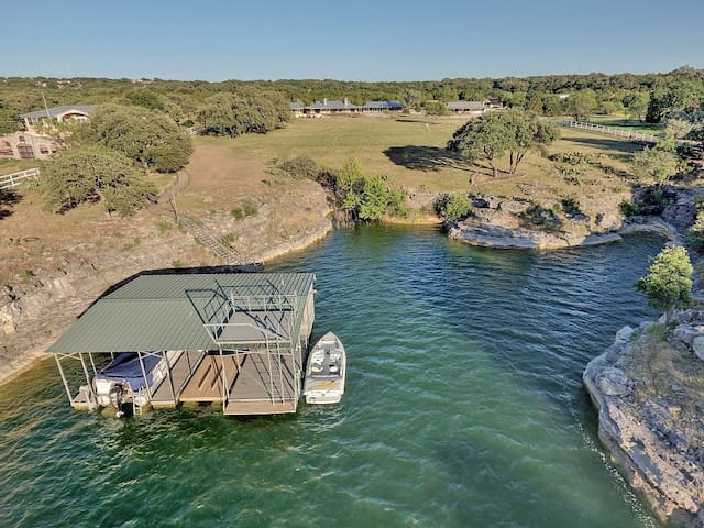 Private cove with 2 slip boat dock. Pontoon Boat, owners closet, Stand up paddle boards, and kayaks are available for rent
