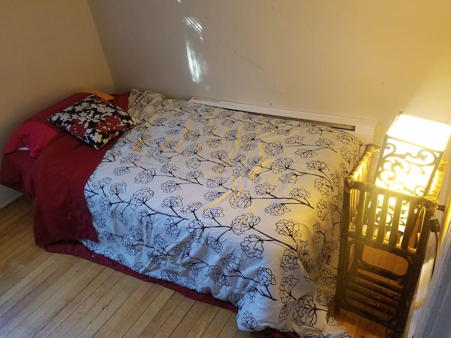 This is the smaller room that fits a queen bed snugly!