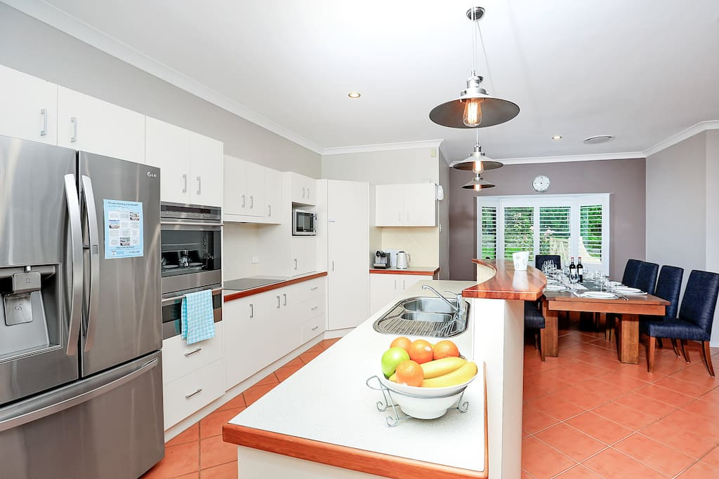 well equipped kitchen and open plan dining