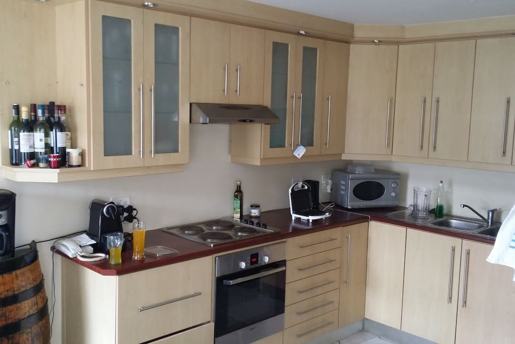 Large, modern kitchen with numerous cupboard spaces