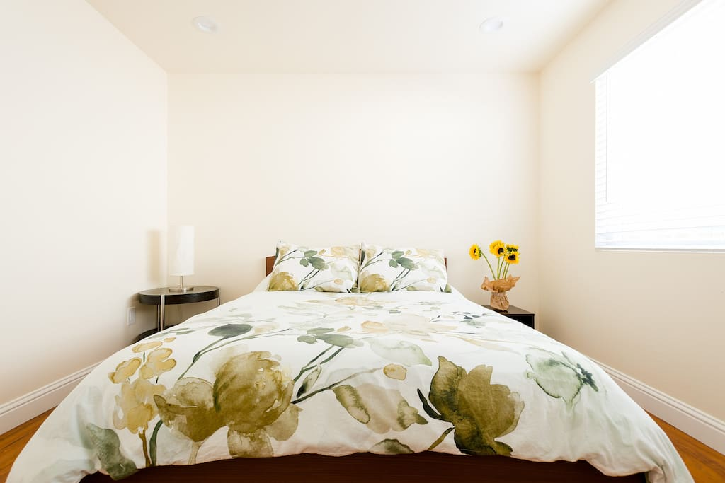 Cotton sheets and floral duvet.