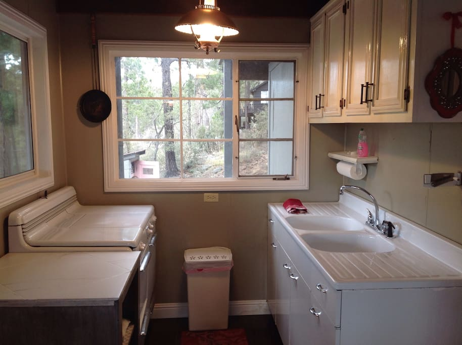 Full kitchen with antique metal propane stove.