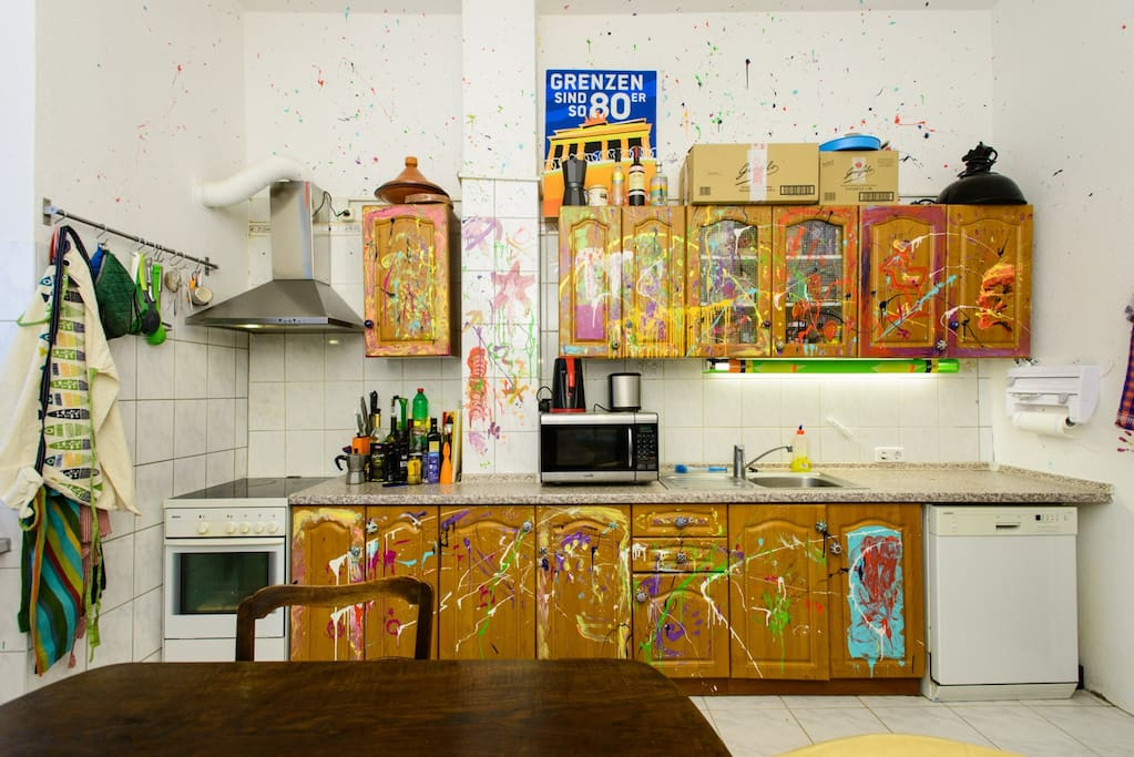 Our funky, paint-splattered kitchen cabinets.