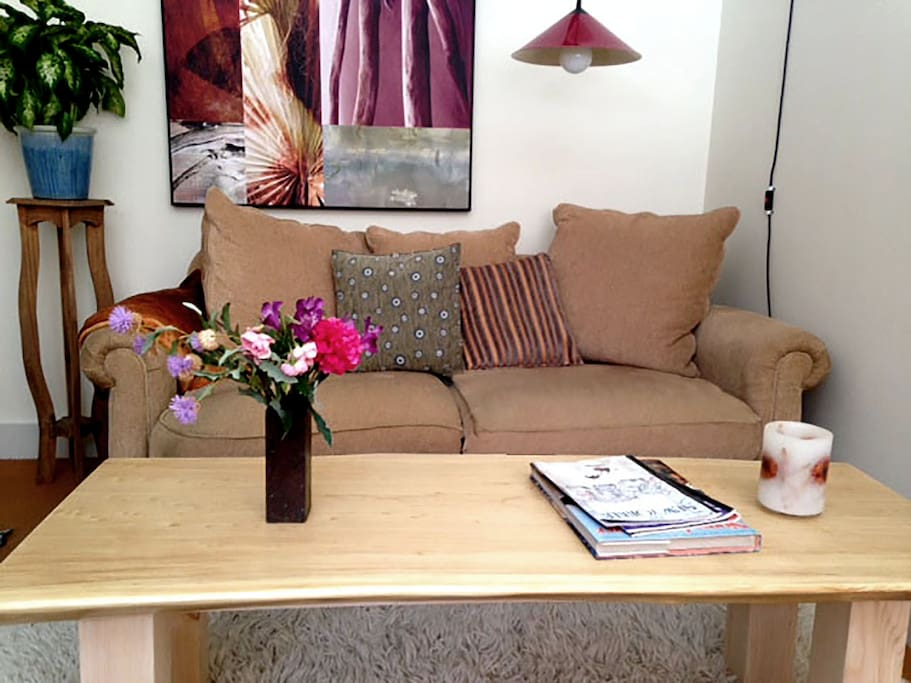 A beautiful hand made coffee table. The view from your super cozy  bed