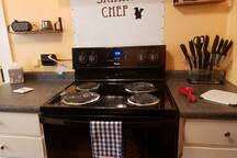 Full kitchen stove, full size frig, dishwasher, Keurig with coffee and drink assortments