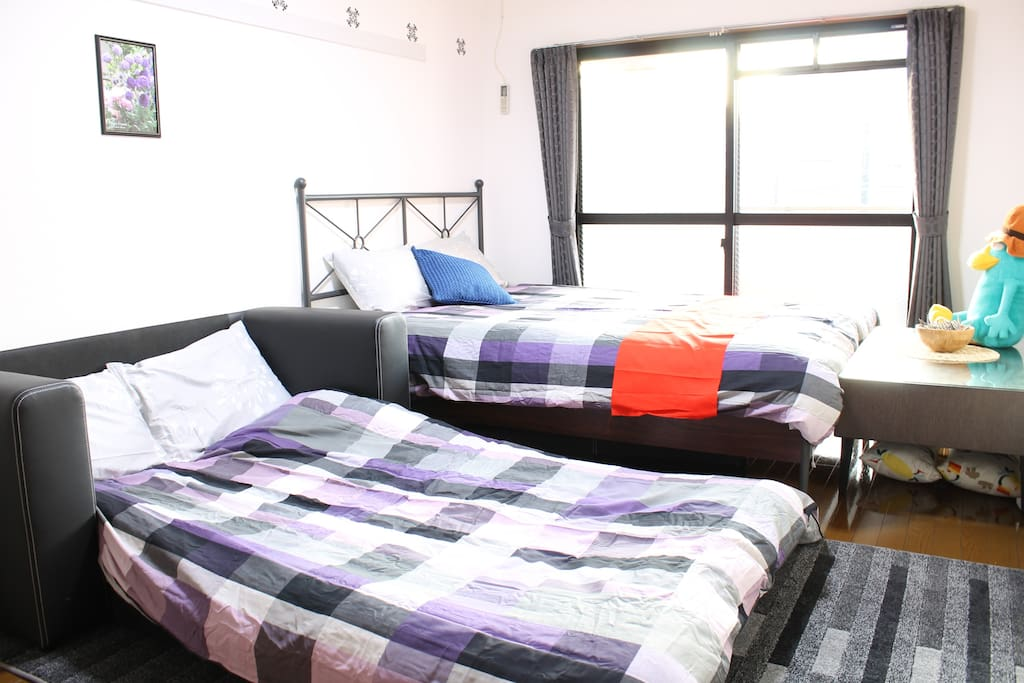 A double bed and a semi double sofa bed are provided.