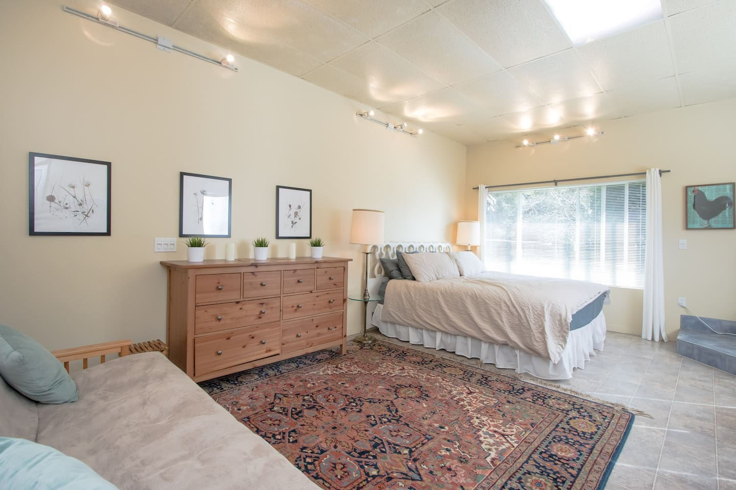 Light filled studio king size bed & dresser