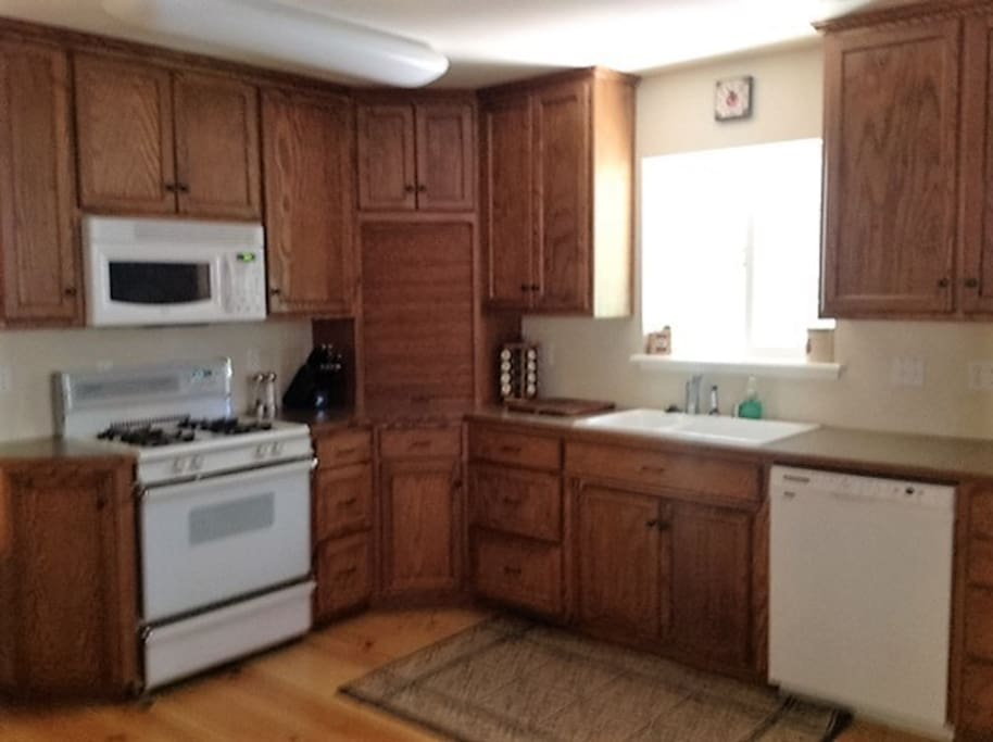 The cabin kitchen offers all the amenities of home. Kitchen includes gas stove, oven, dishwasher, electric can opener, coffee pot, toaster and crock pot.
