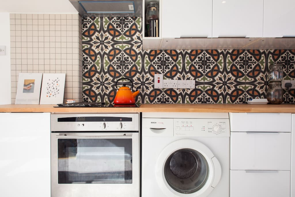 Newly renovated kitchen, with Moroccan tiles, dishwasher, and induction hob cooker.  Lots of cooking tools and cook books.