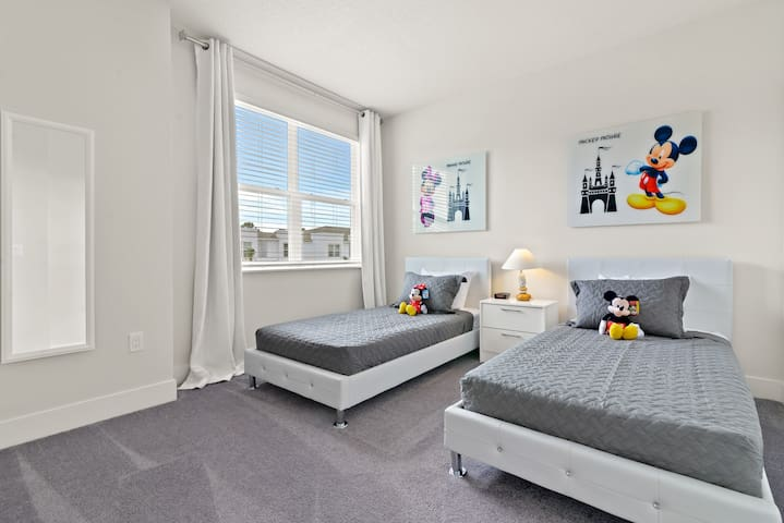 The room features two twin beds for the little ones