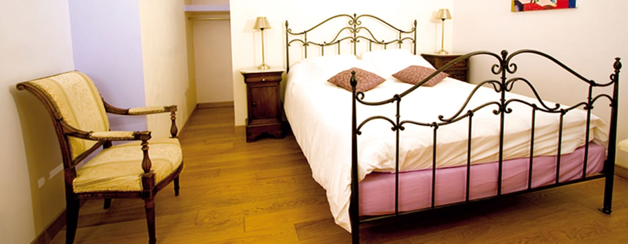 Bedroom with kingsized bed and private bathroom