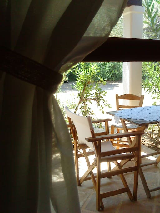 The private veranda has dinnertable, coffeetable, chairs and sunbeds as well as hammock.