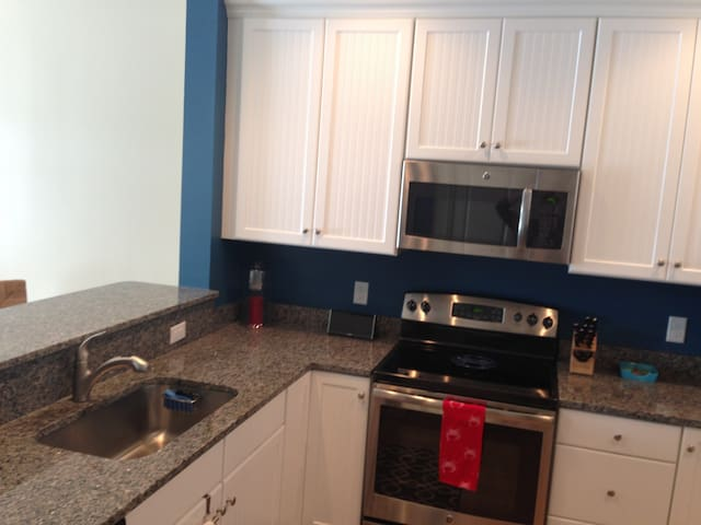Fully equipped kitchen with coffee maker, KitchenAide mixer, waffle maker. Granite countertops, GE upgraded appliances
