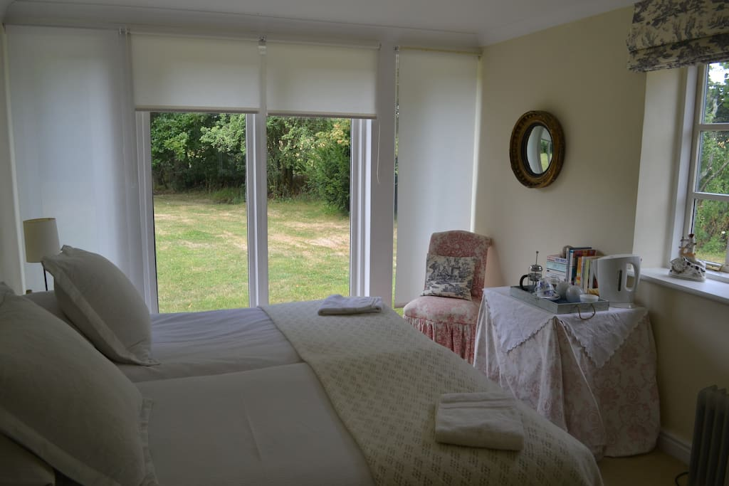 Good sized Double bedroom with hand basin,  Very light and sunny double aspect.  Private bathroom, Tea and coffee facilities