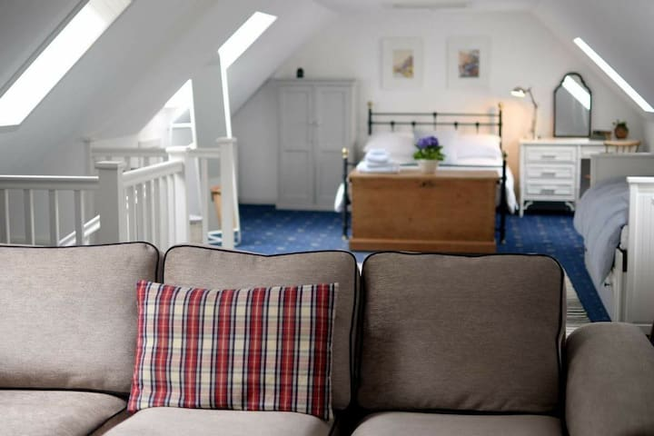 The loft is a light, airy and spacious room for you to make your own