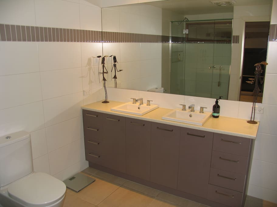 En-suite with twin basin and twin shower.