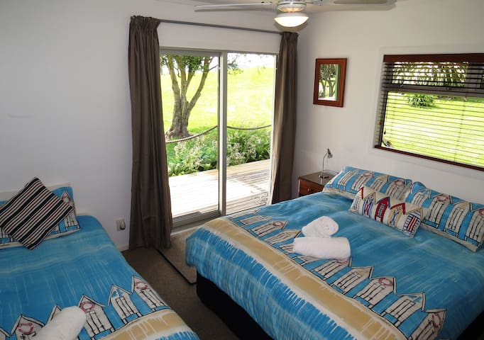 Front bedroom King and Single with sea views and outdoor access. 4 bedrooms sleep 2-13 guests