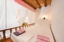 "Traditional house. ""Apokrevatos"": wooden loft bed. The newlyweds' bedroom."