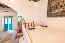 "Traditional house. ""Abataros"": wooden loft bed."