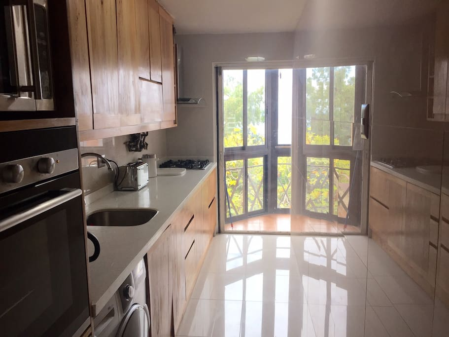 Kitchen with marbel desk, electric oven, microwave and dishwasher. 2015 photo