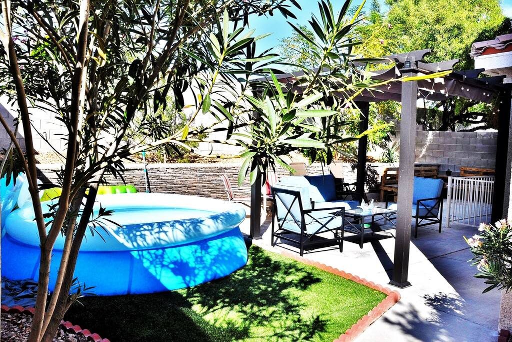 Backyard, including chemically treated mini-pool (available April to October)) and lounging area.