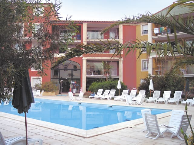 Relax under the sun around the outdoor swimming pool.