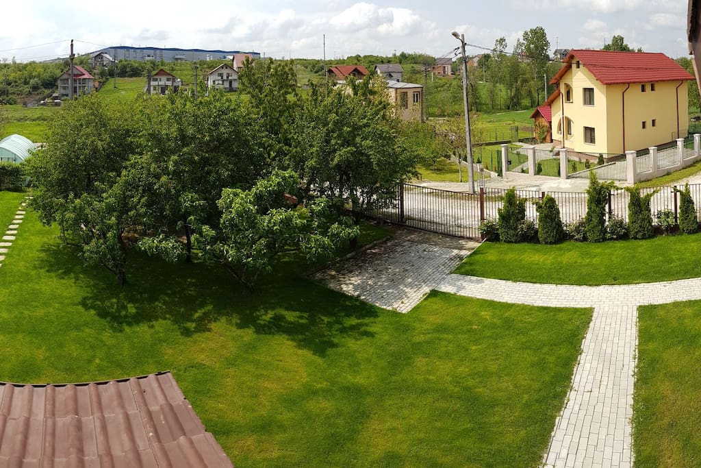 Balcony view of the yard and parking place