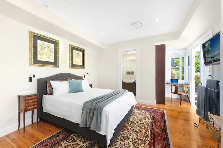 Bedroom includes pillow top mattress, feather doona and pillows, individual reading lights. There is a marble finished ensuite and study nook.