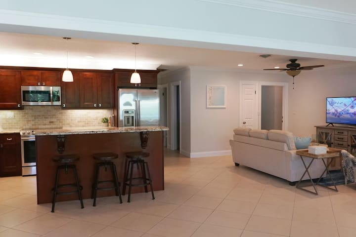 The kitchen comes fully equipped - double sink, full sized refrigerator with filtered water and ice dispenser, dishwasher, range, microwave, Keurig coffee machine, toaster and all the other small appliances, utensils and cookware you will need.