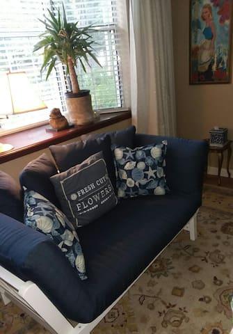 New comfy futon sofa bed under the bay windows!
