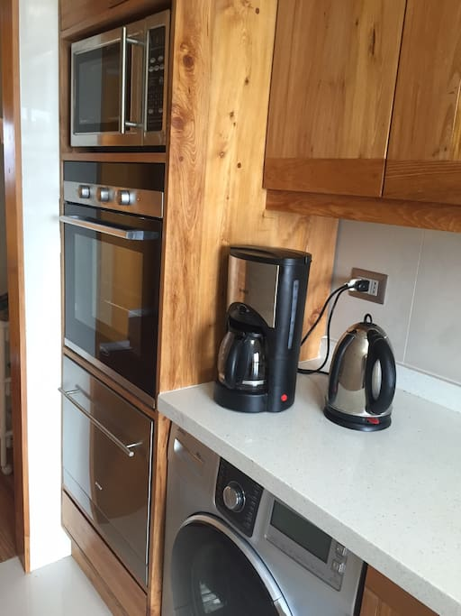 Microwave, oven, dishwasher, cloth washer, coffee maker and water heater. 2015 photo