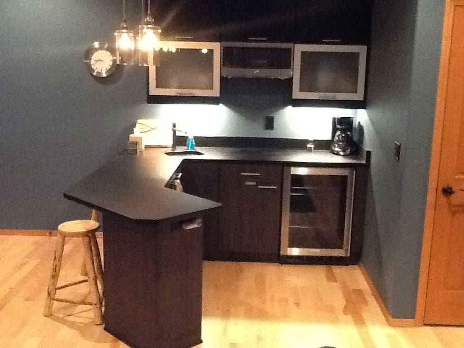 Kitchenette. Sink, Microwave, refrigerator. Fully stocked with dishes and utensils.