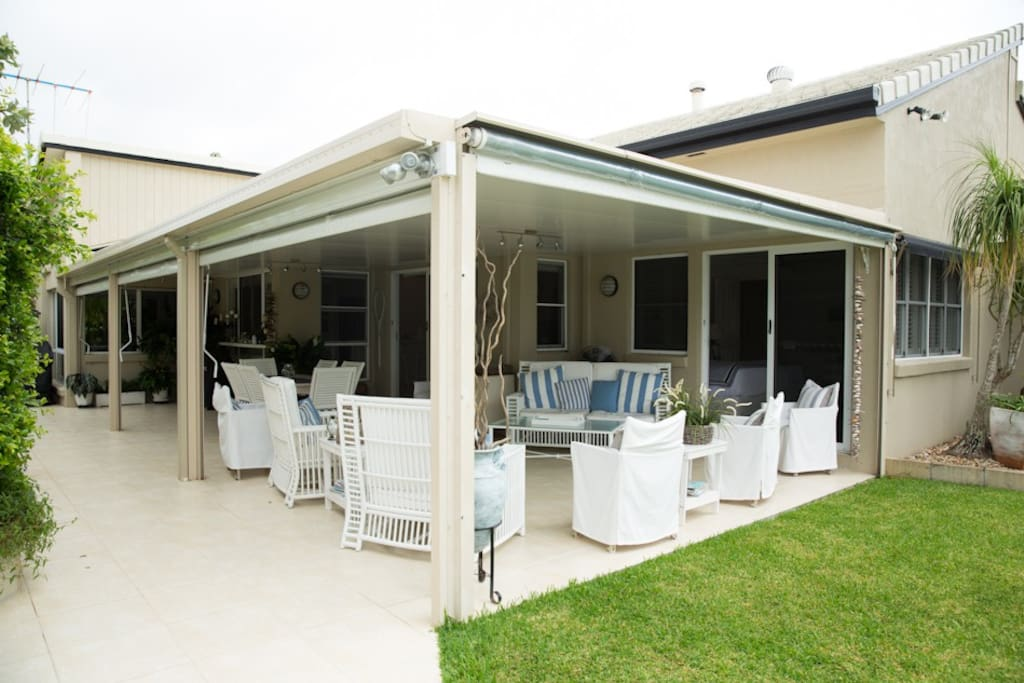 Fully furnished covered outdoor entertaining area. PVC bistro blinds allows year round use.