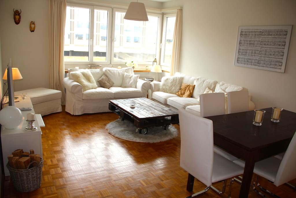 Spacious and beautiful living / dining room with comfy 2- and 3-seat sofa, TV, dining table for 6-8 people