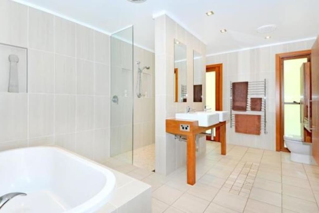 Luxurious bathroom with double sink, shower and bath tub