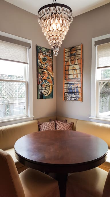 The warm and inviting banquette is roomy and features local folk art and a stunning chandelier.
