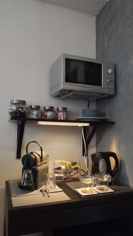 nespresso machine, waterboiler, noiseless fridge and new: microwave and dvd player.