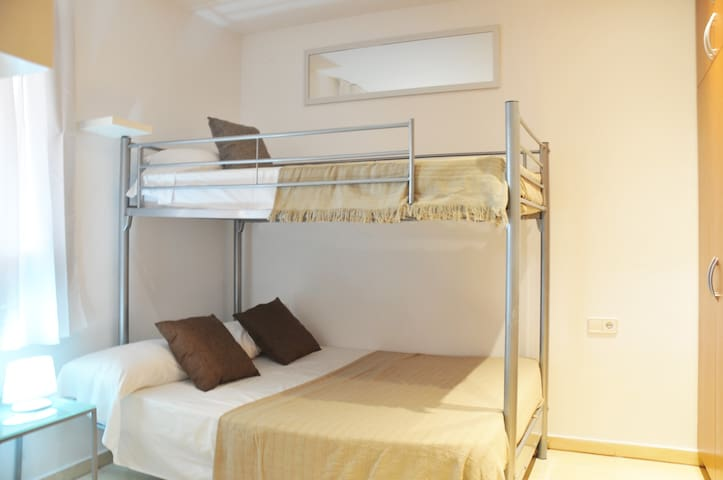Second bedroom with bunk bed and capacity for 3