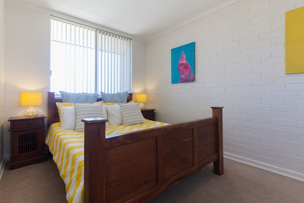 Bright and chirpy bedroom with comfortable queen size bed