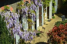 The gite faces south with double doors opening onto the garden from every room.  We are listed with the local tourist office (awarded three stars).  YOU DO NOT SHARE THE COTTAGE OR THE COTTAGE GARDEN WITH ANYONE ELSE.