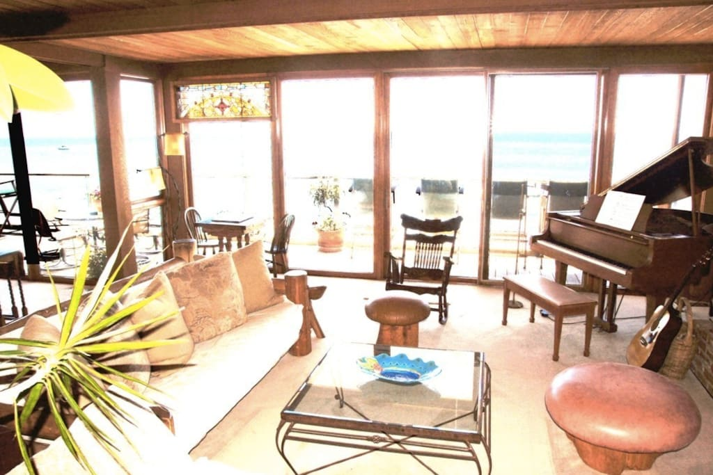 VIEW FROM DINNING ROOM ACROSS LIVING ROOM AND DECK SEATING