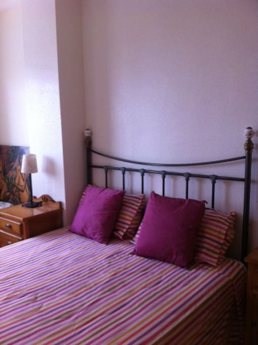 Main room with two bed tables and a wardrobe. Double bed has 150 cms. wide by 190 cms. length.