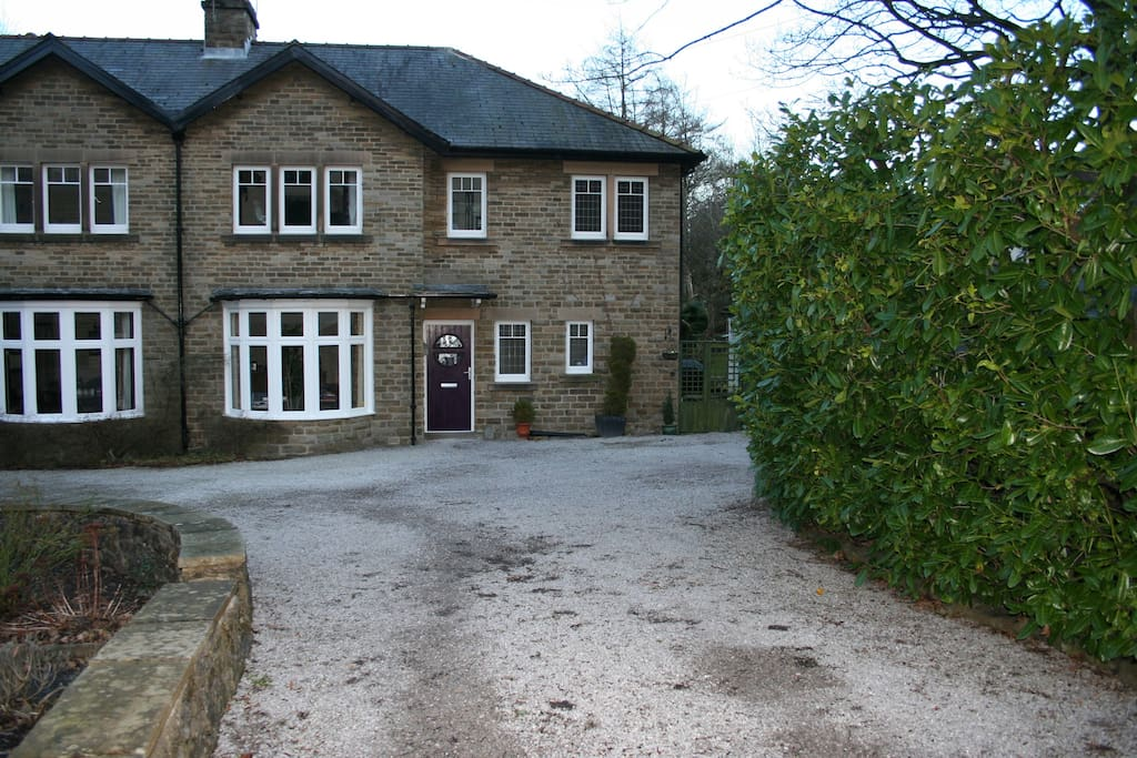 Front view, driveway and parking.
